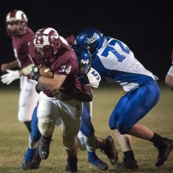 Matt Duff of Bangor High School carries the ball under pressure from Lewiston players Tahj Fulcum (5) and Julian Smedley (72) during an Oct. 10 game.