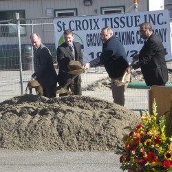 Gov. Paul LePage (third from left) turns ceremonials shovels of sand with company officials at a groundbreaking ceremony marking construction of the St. Croix Tissue plant at the Woodland Pulp mill in Baileyville.