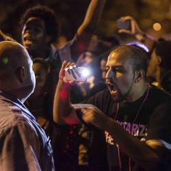 Missouri shooting victim's father calls for peace after riots