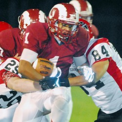 Running back Dane Johnson (middle), shown during a Sept. 12 game against Scarborough, will be among the key players for Bangor when it takes on Windham in a battle of unbeaten teams on Friday night.