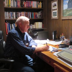 "Bob Tweedie of Westfield sits at the desk where he spent about seven years writing the book ""Events."""