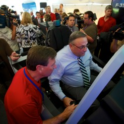 LePage, Collins court defense contractors at jet fighter cockpit simulation