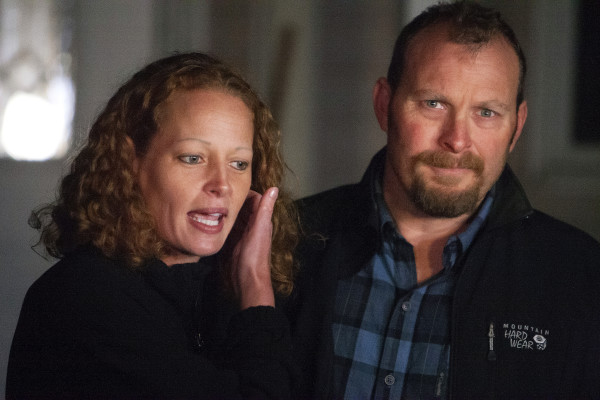 Kaci Hickox (left) and Ted Wilbur address the media during a informal press meeting on Wednesday outside their home in Fort Kent.