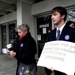 """Daniel Bahun, a second-year student at the University of Southern Maine who is majoring in French, said he was standing outside Sullivan Gym as hundreds entered the building to attend a board of trustees meeting to """"fight for the French program and my education here."""" The board voted to cut undergraduate French and graduate applied medical sciences."""