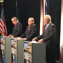 Independent Eliot Cutler (from left), Republican Gov. Paul LePage and Democratic Rep. Mike Michaud participate in a debate on Tuesday in Auburn.