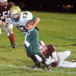 Oxford Hills High School's Brady LaFrance attempts to break a tackle by Bangor High's Tanner Goodine during their game at Cameron Stadium in Bangor Friday evening.