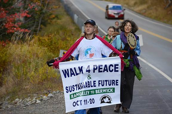 Jason Rawn of Hope takes the lead as the Walk for Peace and & Sustainable Future approaches Farmington.