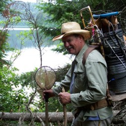 Instructor David Halliwell trapping minnows