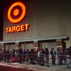 People brave the cold while waiting of the doors to open at Target in Bangor on Thursday night before Black Friday shopping.