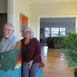 Katie and Allen Schaffer sit together on a fish bench, one of many unique artistic touches in the Bangor home, which they have fully renovated together.