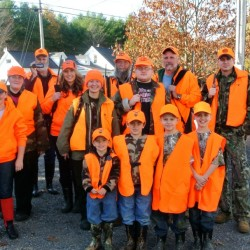 Members of the Tracy family, including Sasha Tracy (middle row, green coat), gather on opening day of deer season. A similar Thanksgiving deer hunt is among the family's traditions.
