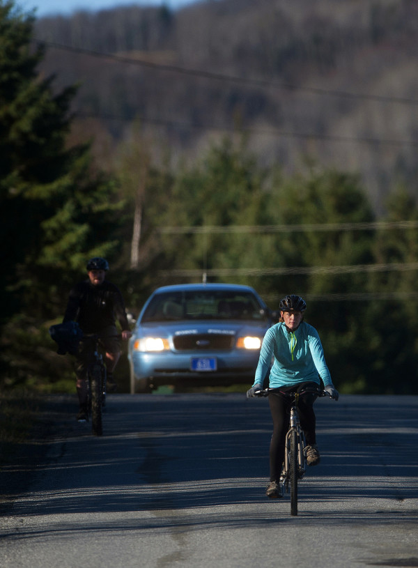 Kaci Hickox (left) and boyfriend Ted Wilbur go for a bike ride in Fort Kent in this October 2014 file photo.
