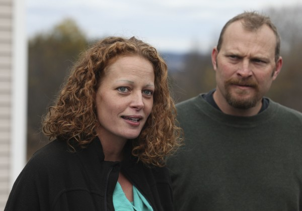 Kaci Hickox (L) joined by her boyfriend, Ted Wilbur, speak with the media outside of their home in Fort Kent in this October 2014 file photo.