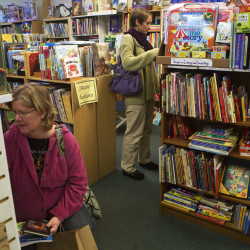 Leslie Farrington (left) and Morgan Mazzei browse a selection of books at the Briar Patch in downtown Bangor Tuesday.