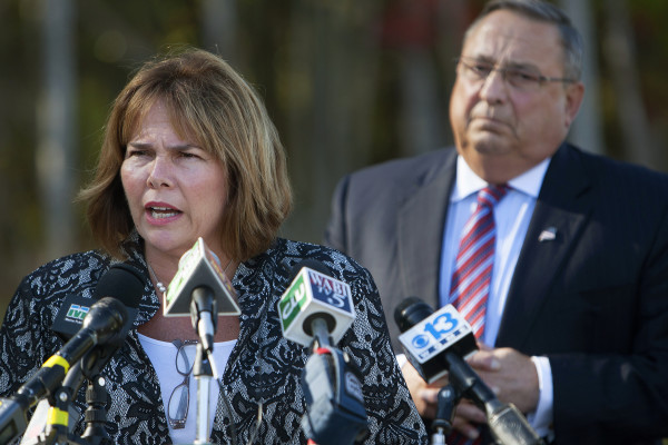 Maine Commissioner of Labor Jeanne Paquette (left) addresses the media during a press conference with Gov. Paul LePage regarding the announcement of the Verso paper mill closure in Bucksport in October outside Maine Military Supply in Holden.