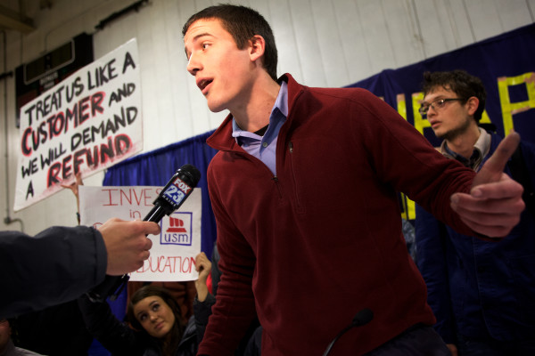 USM political science major Neal Young lists protesters' demands as they interrupt and briefly occupy a University of Maine System trustees meeting on Monday in Portland.
