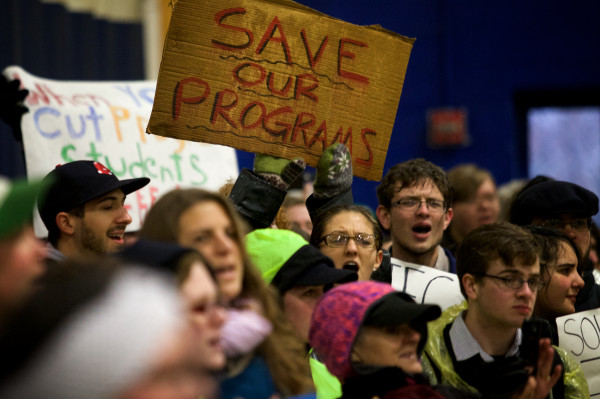 Sign-waving, chanting protesters interrupt a University of Maine System trustees meeting and demand an end to recent faculty and program cuts on Monday in Portland.