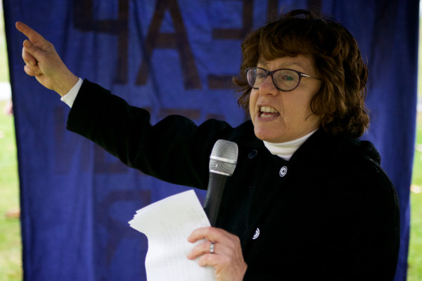 Professor Susan Feiner leads the call for USM students to march to a University of Maine System trustees meeting and demand an end to faculty and program cuts on Monday in Portland.