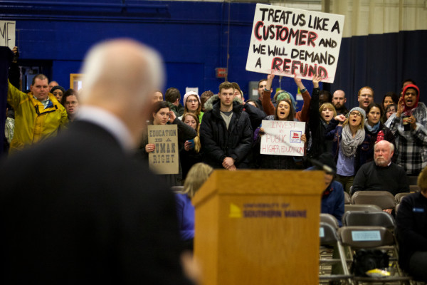 University of Southern Maine President David Flanagan (back to the camera) tries to talk to students protesting faculty and program cuts on Monday in Portland.