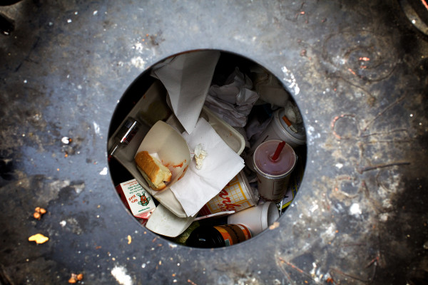 Waste mounts up inside a Portland trash can in the Old Port on Monday.