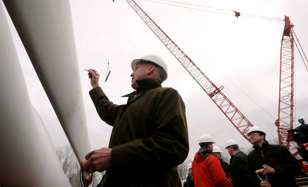 Paul Gaynor the CEO of the Massachusetts-based First Wind, signs one of the blades on the first windmill to be erected as part of the Stetson Wind project expansion in Township 8 Range 4 in 2009.