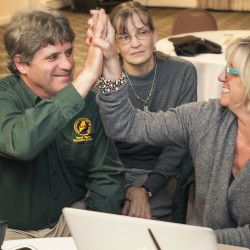 Executive Director of the Sportsman's Alliance of Maine David Trahan, left, Pam Trahan, and Michelle MacLean, right, consultant of the Save Maine's Bearhunt campaign, react to returns in the  Vote No on 1 campaign headquarters in Orono, Maine, Tuesday. Nov. 4, 2014.