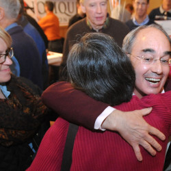 Bruce Poliquin is greated by supporters at his election night celebration at Dysart's on Broadway in Bangor Tuesday evening.