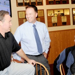 Eric Samson, center, talks with his brother Mark Sampson, left, and Chris Fletcher at Gipper's Sports Grill in Auburn on Tuesday. Samson was elected Androscoggin County Sheriff.