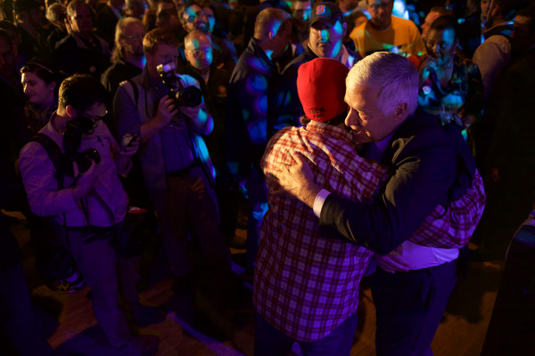 Mike Michaud hugs a supporter in Portland early Wednesday morning after conceding defeat in the governor's race.