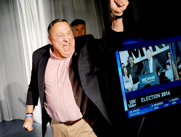 Gov. Paul LePage celebrates at the Franco Center in Lewiston early Wednesday morning as Mike Michaud makes his concession speech on television.