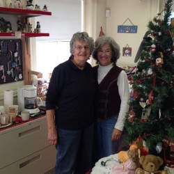 "Gayle Crowley and Mary Banfield, two organizers of the Santa's Workshop at the Senior Center, stop to take a quick photo in their ""winter wonderland""."