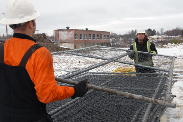 Workers from SumCo Eco-Contracting, LLC began installing security fencing last week as construction of the Penobscot River Restoration Trust's fish bypass continued this week in Howland.