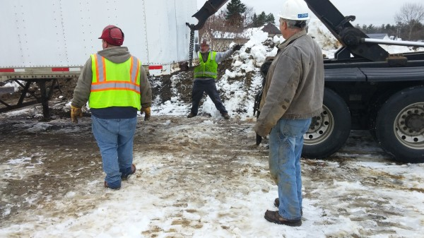 Workers from JE Butler LLC move trailer boxes off the former Howland tannery site on Wednesday, December 23, 2014.
