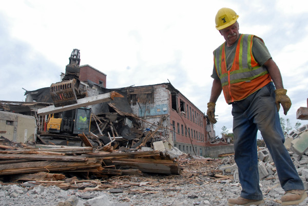 Tom Pelkey of Eddington, an equipment operator with J.E. Butler LLC of Holden, spent most of the day watching for and helping gather recyclable debris at the former Howland tannery building on Thursday, July 26, 2012.