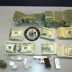 Cocaine, heroin, cash and a loaded gun allegedly seized during a drug raid in Biddeford in this September 2013 file photo.