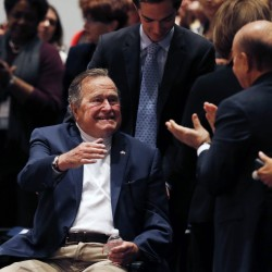 George H.W. Bush improving, but still hospitalized