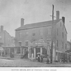 The Hayford Estate buildings were located at the corner of Hammond and Franklin streets where the U. S. Post Office is located today. This photograph dates from around 1906 when the corner was being considered as a location for a new Bangor library.