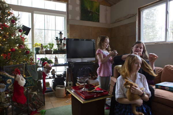 Jennifer Jacques (right) helps put her daughter Asha Kirkland's hair into pigtails while her other daughter, Aria Tapman, 6, watches in their Itty Bitty House in Orland on Saturday.