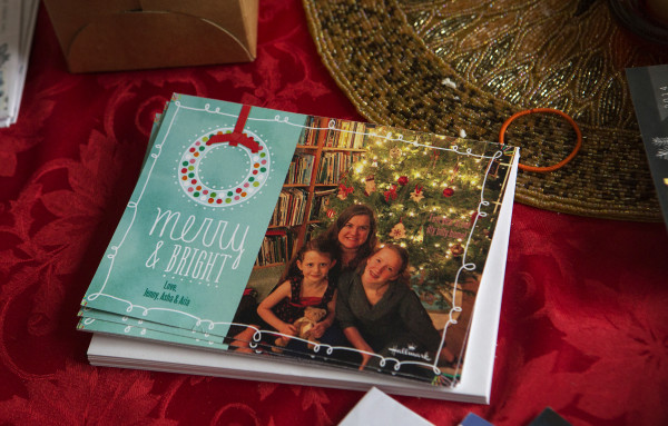 A holiday card showing Jennifer Jacques (center) with her two children, Aria Tapman (right), 6, and Asha Kirkland, 13, sits on the family table in their home in Orland on Saturday.