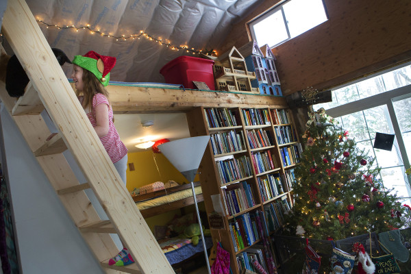 Aria Tapman, 6, plays with one of her cats in her family's Itty Bitty House in Orland on Saturday. Jennifer Jacques and her daughters are spending their first official Christmas in the old garage turned home.