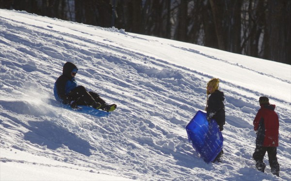 A sledder gets air after going off a jump at Hayford Park in Bangor.