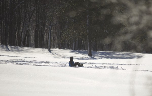 A sledder goes down a hill at Hayford Park in Bangor.