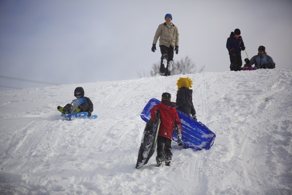 Sledders take to a hill at Hayford Park in Bangor.