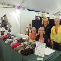 "Pam Mailman, Karen Gallop, Louann Ritchie, and Tricia McCarthy, four sisters from Houlton, Maine, created a craft business called ""Syn-Cyr-Ly Sisters."" They are pictured here at their first experience at a vendor's event, last August at the American Folk Festival on the Bangor Waterfront."