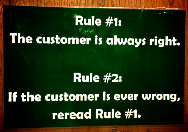 Signs hanging inside the the L.L. Bean flagship store create a culture of hospitality.