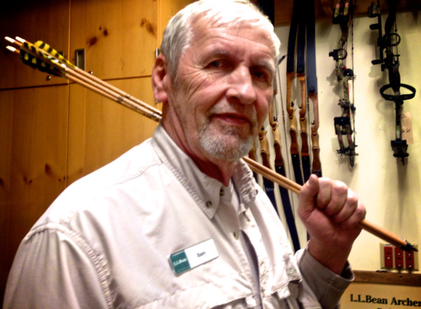 Sam Coffin helps customers learn the inns and outs of archery in the in-store range.