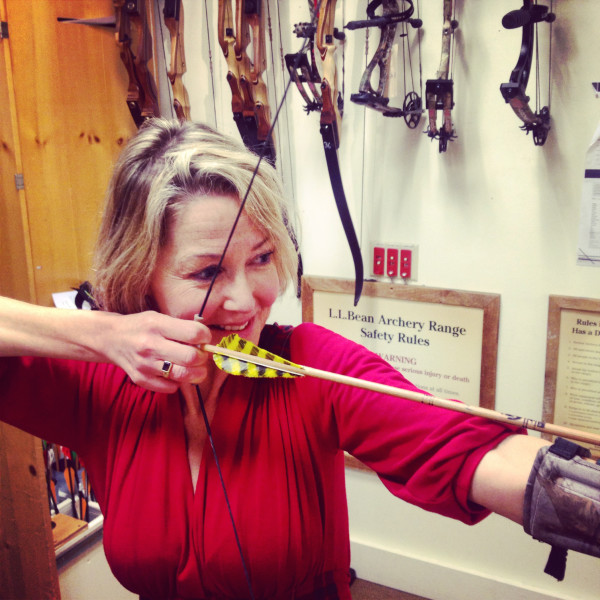 BDN writer Kathleen Pierce tries out the bows in the archery range.