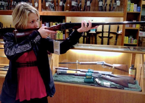 BDN writer Kathleen Pierce poses with a gun.