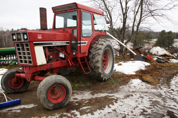 A tractor is parked near the barn at Treble Ridge Farm in Whitefield on Friday. Farm owner Rufus Percy said a credit union aimed at small, organic farms in Maine might help him purchase better used equipment.