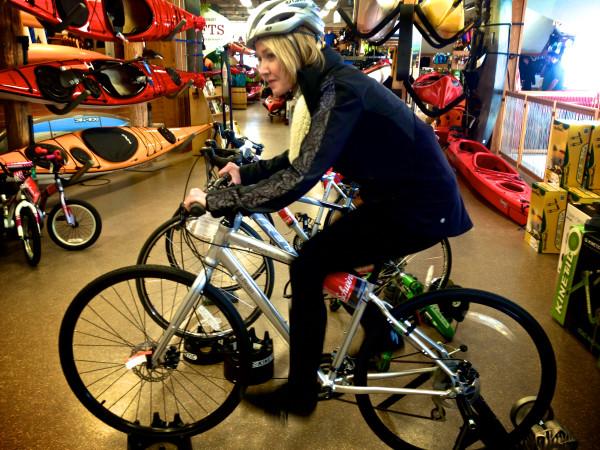 BDN writer Kathleen Pierce tries out a bike in the Boat, Bike and Ski store.